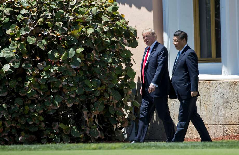 President Trump, shown walking with President Xi Jinping of China in April in Florida, has vowed to reduce America's trade deficits. Photo: DOUG MILLS, NYT