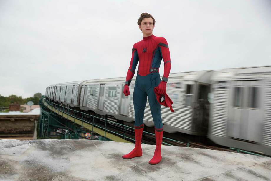 """This image released by Columbia Pictures shows Tom Holland in a scene from """"Spider-Man: Homecoming."""" (Chuck Zlotnick/Columbia Pictures-Sony via AP) ORG XMIT: NYET454 Photo: Chuck Zlotnick / © 2016 CTMG. All Rights Reserved."""