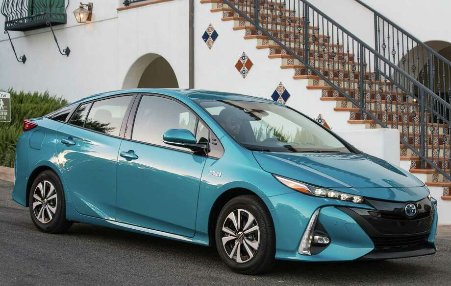 The 2017 Toyota Prius Prime is a plug-in version of the groundbreaking hybrid car. This one can run about 25 miles on battery power alone, and can be recharged using a regular household 110-volt power outlet in about five hours. Photo: Toyota  / dewhurstphoto