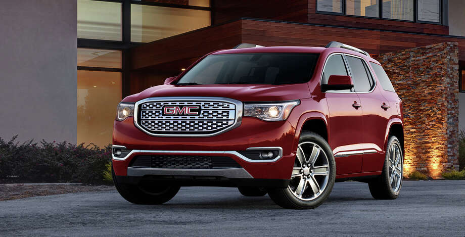 GMC offers seven trim levels of its midsize Acadia SUV and for 2017, buyers can choose between a 2.5-liter four-cylinder or an updated 3.6-liter V6. Photo: GMC