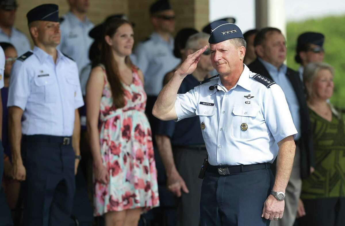 Gen. David Goldfein, Air Force Chief of Staff, salutes as he presides over the basic military training graduation parade at Joint Base San Antonio-Lackland on Friday, June 16, 2017.