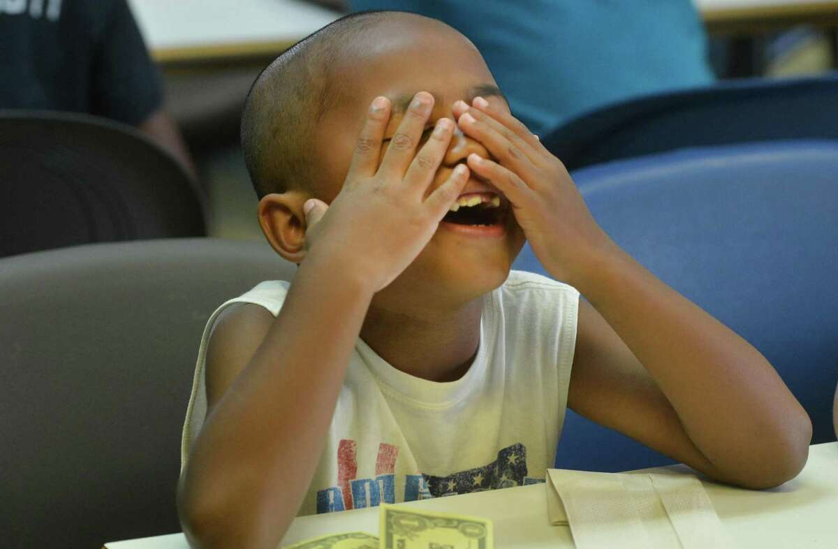 Second grader Ricky Walker reacts during a math lesson at the Norwalk Housing Authority Learning Center at Colonial Village on Thursday June 29, 2017 in Norwalk Conn