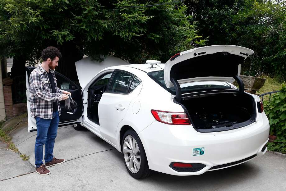 Eddie Samuels works under the hood of a 2016 Acura ILX test car at Comma.ai's headquarters. Photo: Paul Chinn, The Chronicle