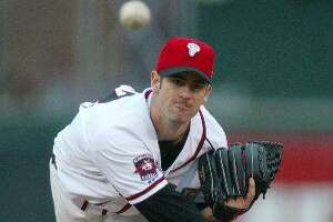 Chicago Cubs' Mark Prior delivers a pitch for the Lansing Lugnuts against the West Michigan Whitecaps, Tuesday, May 25, 2004, in Lansing, Mich. Prior was on a rehabilitation assignment with the Lugnuts.