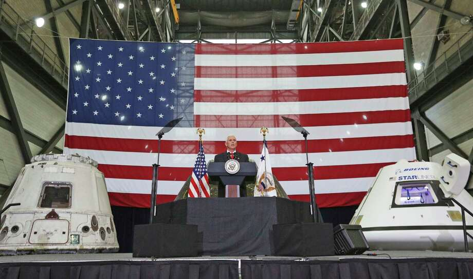 Vice President Mike Pence speaks inside the Vehicle Assembly Building at the Kennedy Space Center in Cape Canaveral, Fla., on Thursday, July 6, 2017. Pence is leading a newly revived National Space Council. (Red Huber/Orlando Sentinel via AP) Photo: Red Huber, MBO / Orlando Sentinel