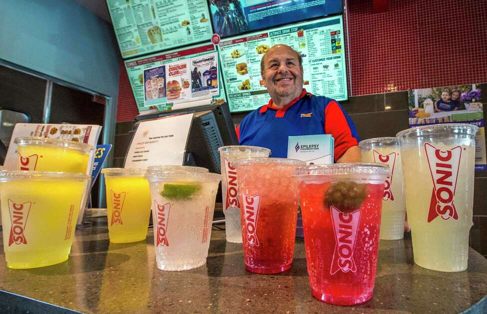 Sonic franchisee Gene Nachamkin sets out some of his lemonade products at the kick off of the