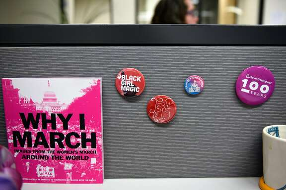 Buttons are seen on the wall of an employees cubicle at the Transgender Law Center offices in Oakland, CA, on Friday June 30, 2017.
