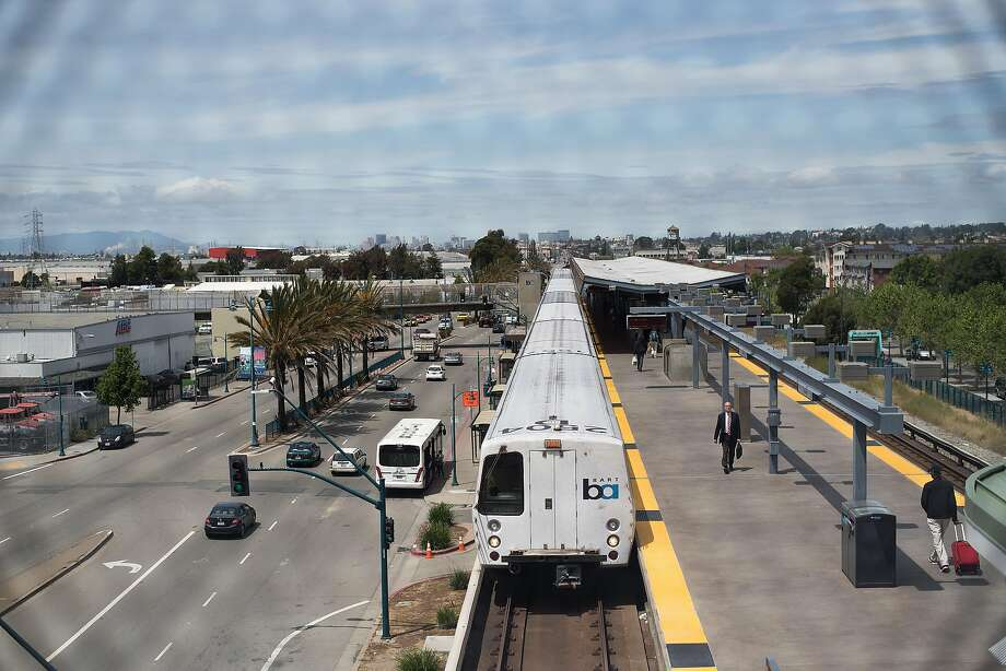 A train leaves the Coliseum BART station on Tuesday, April 25, 2017, in Oakland, Calif. The station is closed as police investigate a reported stabbing, officials said. Photo: Noah Berger / Special To The Chronicle