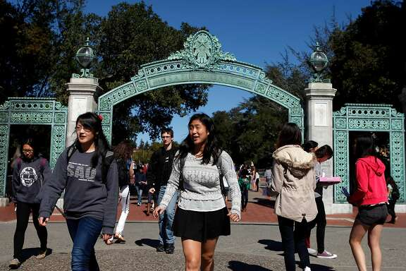 Students walk past  Sather Gate into Sproul Plaza on the Cal campus in Berkeley, CA, Tuesday, March 11, 2014. As the state Legislature weighs placing a ballot measure to restore the ability of California universities to use race and ethnicity in admissions decisions, the Asian American community has a wide variety of opinions on the issue.