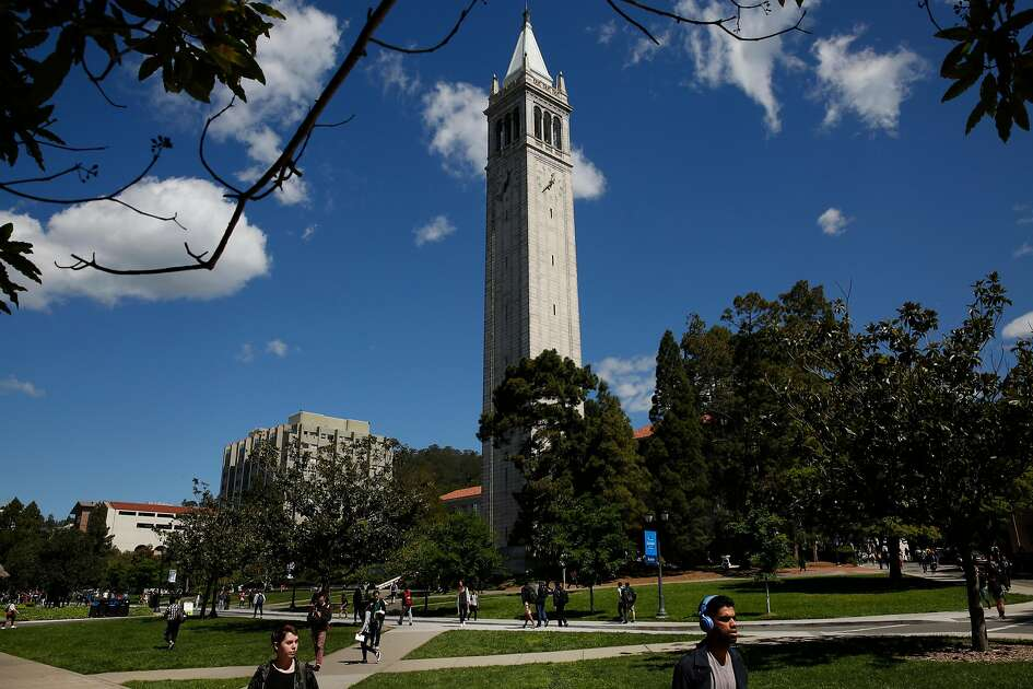 People walk past The Campanile at University of California, Berkeley campus March 29, 2016 in Berkeley, Calif.