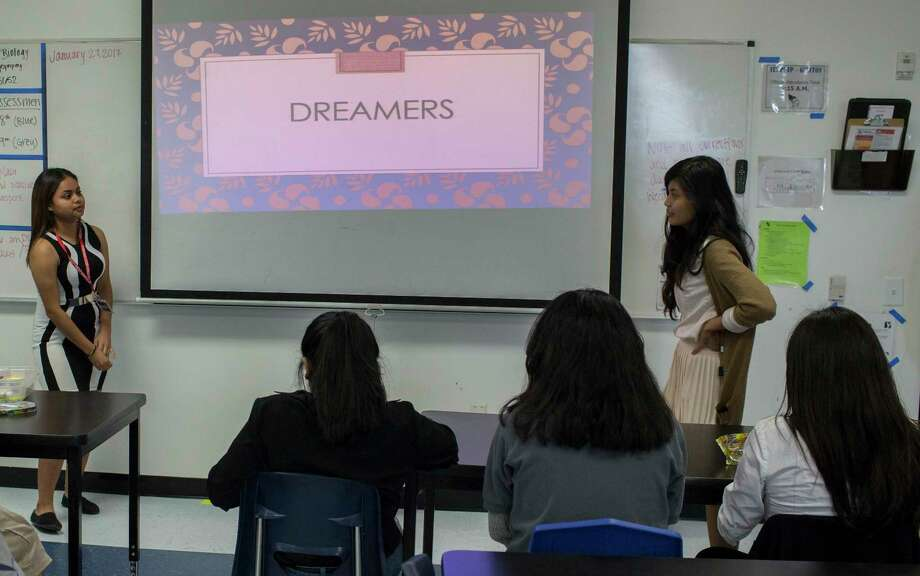 """YesPrep Gulfton student Claudio Canas, left, 15, and school teacher Vida Pascual, right, speak to other students as the """"dreamer"""" club starts session, Thursday, Jan. 26, 2017, in Houston. The """"dreamer"""" club is a safe space for students who want to support immigrants and undocumented students during the current time of uncertainty in relation to the Deferred Action for Childhood Arrivals also known as DACA. ( Marie D. De Jesœs / Houston Chronicle ) Photo: Marie D. De Jeséºs, Staff / © 2017 Houston Chronicle"""