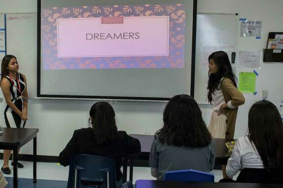 "YesPrep Gulfton student Claudio Canas, left, 15, and school teacher Vida Pascual, right, speak to other students as the ""dreamer"" club starts session, Thursday, Jan. 26, 2017, in Houston. The ""dreamer"" club is a safe space for students who want to support immigrants and undocumented students during the current time of uncertainty in relation to the Deferred Action for Childhood Arrivals also known as DACA. ( Marie D. De Jesœs / Houston Chronicle )"