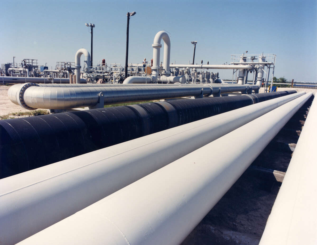 FILE - An undated photo provided by the Energy Department shows crude oil pipes at the Bryan Mound site near Freeport, Texas. Thursday, U.S. Energy Secretary Rick Perry announced his department would deliver a half-million barrels of crude to offset fuel shortages due to Hurricane Harvey