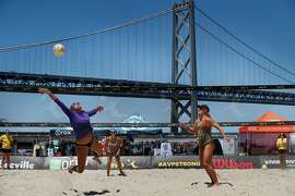The team of Pricilla Pianidosi-Lima, (diving for the ball) and Kerri Schuh, (right ) and Pricilla Pianidosi-LIma, (back right) battle the team of Bella Kuechenberg, (pictured far side) and Shannon Murphy, (not pictured) in a qualifying round as the AVP Tour makes a stop in San Francisco, Ca., on Thursday July 6, 2017. The competition runs through this weekend.