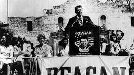 Republican presidential candidate Ronald Reagan addresses a crowd of more 2,000 in front of the Alamo April 18, 1980, in San Antonio. Reagan's wife Nancy is third from the left.