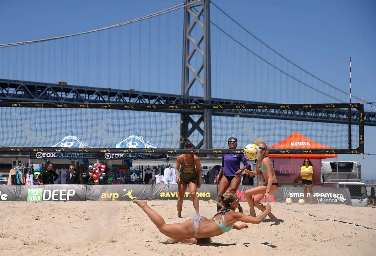 The team of Kerri Schuh, (back left) and Pricilla Pianidosi-Lima, (back right) battle with Bella Kuechenberg, (diving for a ball) and Shannon Murphy in a qualifying round as the AVP Tour makes a stop in San Francisco, Ca., on Thursday July 6, 2017. The competition runs through this weekend.