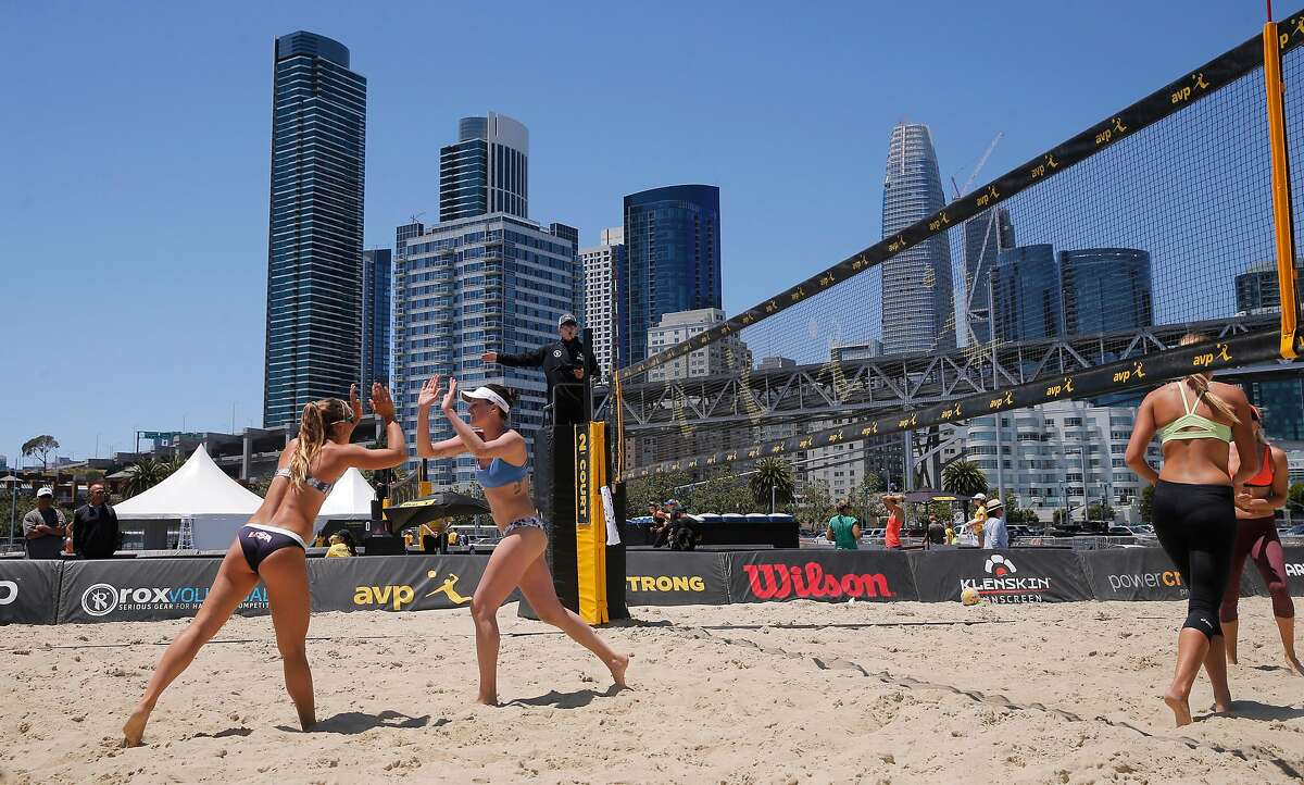 The team of Katie Spieler, (left) and Karissa Cook, celebrate a point as they take on Brittany Howard, (right) and Corrine Quiggle, (far right) as the AVP Tour makes a stop in San Francisco, Ca., on Thursday July 6, 2017. The competition runs through this weekend.