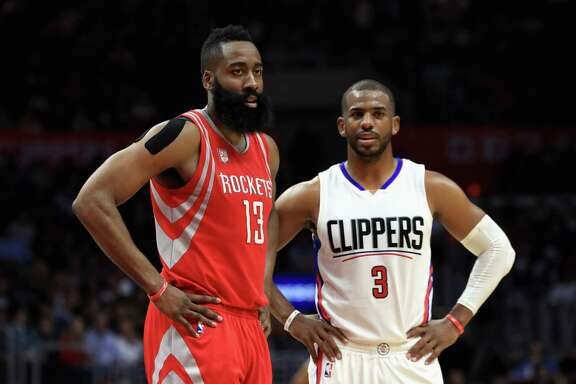 LOS ANGELES, CA - APRIL 10: James Harden #13 of the Houston Rockets and Chris Paul #3 of the LA Clippers look on during the second half of a game at Staples Center on April 10, 2017 in Los Angeles, California.