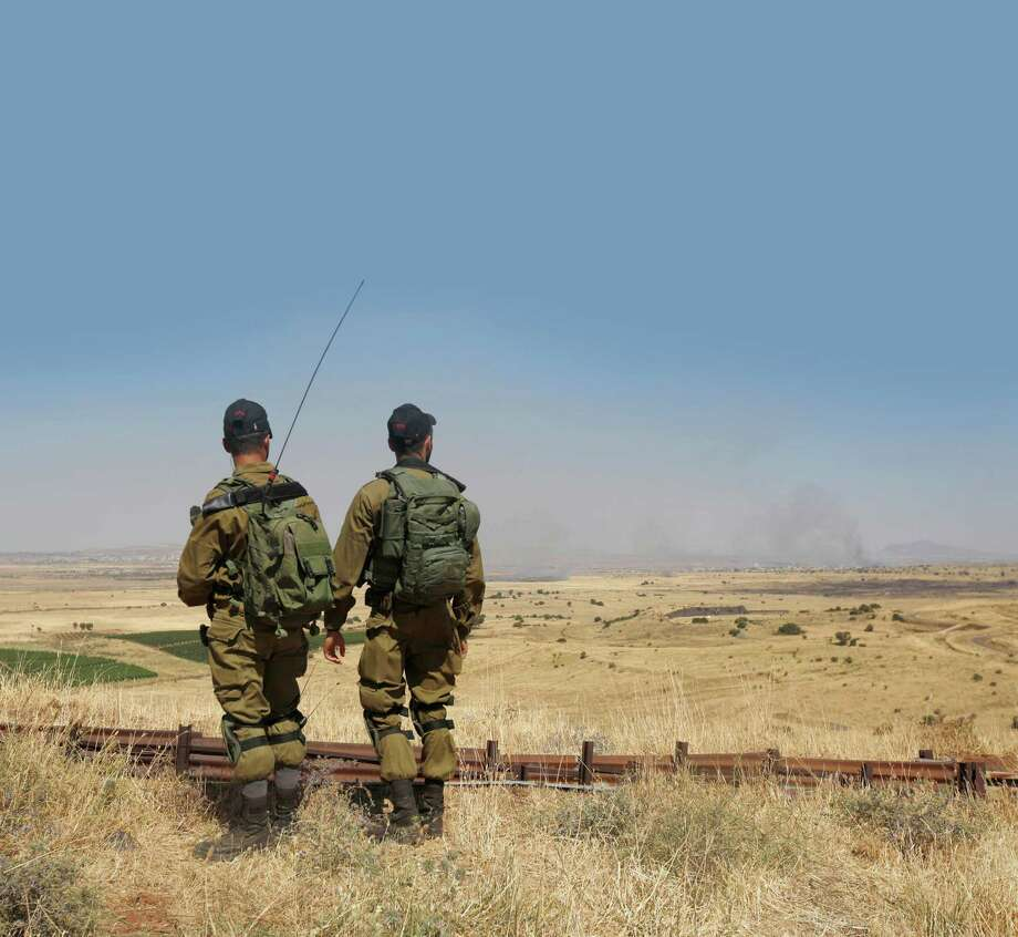 Israeli soldiers patrol near the border with Syria after projectiles fired from the war-torn country hit the Israeli occupied Golan Heights on June 24, 2017. (Jalaa Marey/AFP Getty Images) Photo: JALAA MAREY, Contributor / AFP or licensors