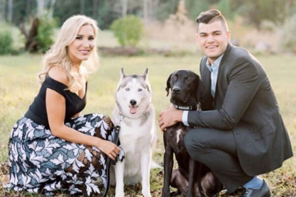 The Astros' Lance McCullers and his wife Kara with their two dogs.