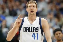 FILE- In this March 7, 2017, file photo, Dallas Mavericks forward Dirk Nowitzki, of Germany, celebrates sinking a three-point basket early in the first quarter of an NBA basketball game against the Los Angeles Lakers in Dallas. A person with knowledge of the agreement says the Dallas Mavericks and Dirk Nowitzki have agreed on a two-year, $10 million deal that assures a 20th season for the star forward.  The second year of the contract carries a team option, the person told The Associated Press, Thursday, July 6, 2017, on condition of anonymity because the team hasn't announced the deal. The 39-year-old Nowitzki is set to join Kobe Bryant of the Lakers as the only players to spend 20 seasons with one franchise.  (AP Photo/Tony Gutierrez, File)
