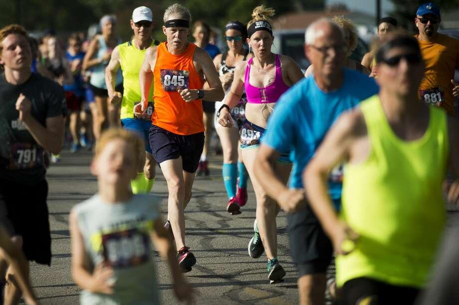 Runners take off at the starting line in the Auburn Cornfest 5K race on Thursday, July 6, 2017 in Auburn. Photo: (Katy Kildee/kkildee@mdn.net)