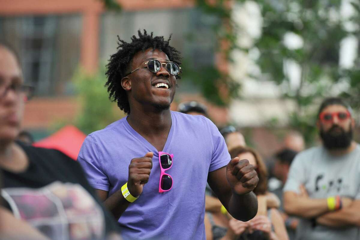 26-year-old Jerrod Jefferson, of Bridgeport, dances in Columbus Park during the first Alive@Five summer concert concert of the summer, which featured CeeLo Green, in downtown Stamford, Conn. on Thursday, July 6, 2017.