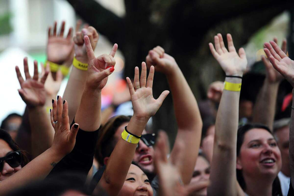 Concertgoers raise their hands in the air during CeeLo Green's performance at the first Alive@Five summer concert of the summer in Columbus Park in downtown Stamford, Conn. on Thursday, July 6, 2017.