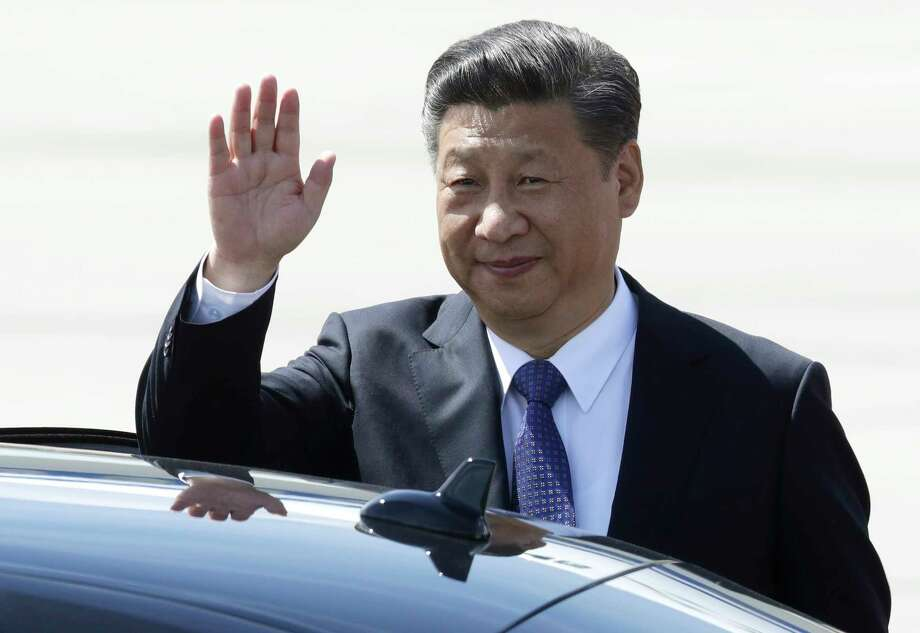 Chinese President Xi Jinping waves as he arrives for the G-20 summit in Hamburg, northern Germany, Thursday, July 6, 2017. The leaders of the group of 20 meet July 7 and 8. (AP Photo/Michael Sohn) Photo: Michael Sohn, STF / Copyright 2017 The Associated Press. All rights reserved.