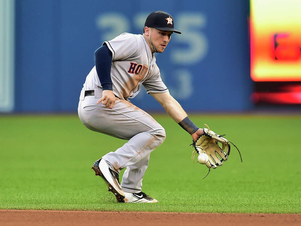 Houston Astros third baseman Alex Bregman commits an error on a ground ball hit by Toronto Blue Jays' Kendrys Morales during the fourth inning of a baseball game in Toronto on Thursday, July 6, 2017. (Frank Gunn/The Canadian Press via AP)