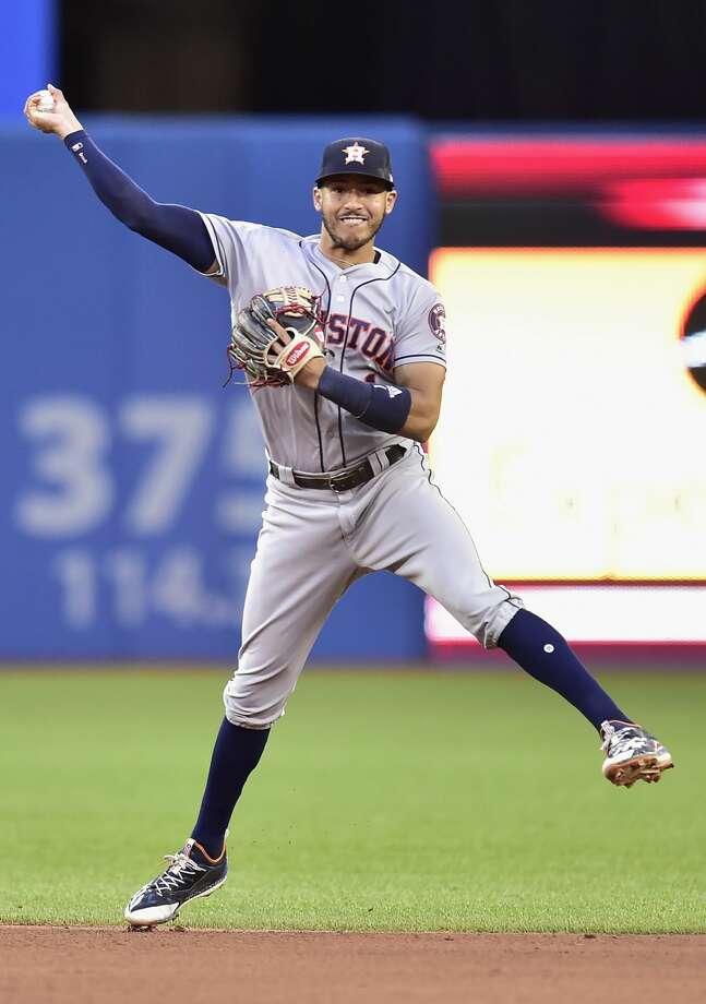 Houston Astros shortstop Carlos Correa throws out Toronto Blue Jays' Troy Tulowitzki at first base during the fourth inning of a baseball game in Toronto on Thursday, July 6, 2017. (Frank Gunn/The Canadian Press via AP) Photo: Frank Gunn/Associated Press