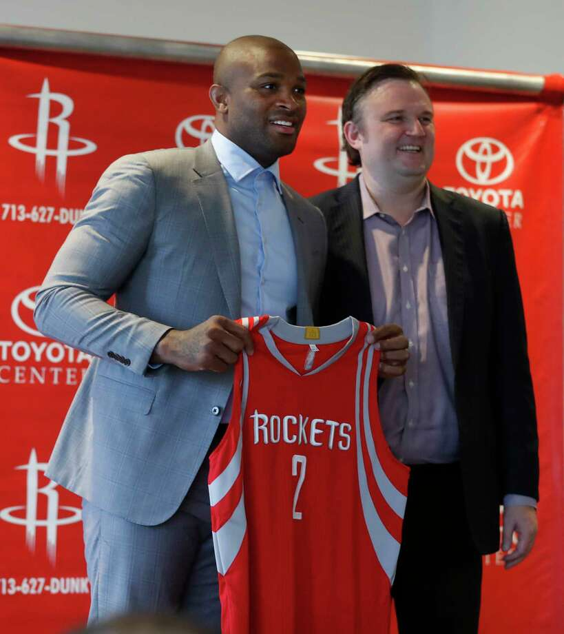 After signing with the Rockets on Thursday, P.J. Tucker, left, was praised by GM Daryl Morey as bringing the toughness and defense the team needs. Photo: Karen Warren, Staff Photographer / 2017 Houston Chronicle