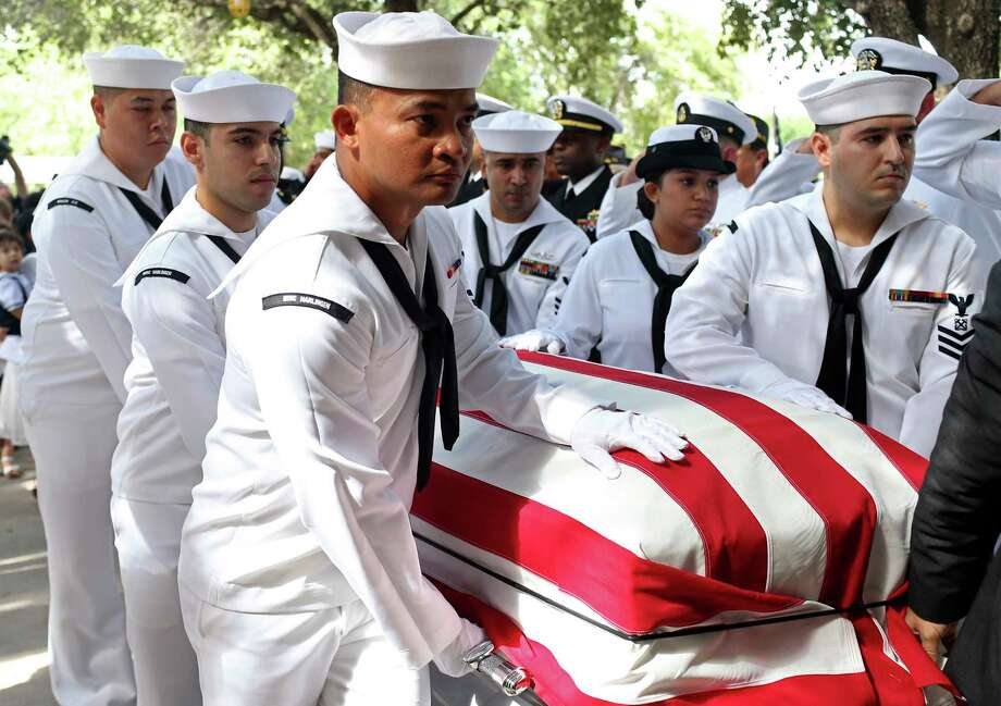 Sailors from the Harlingen U.S. Navy Operational Support Center escort the body of U.S. Navy Gunner's Mate 2nd. Class Noe Hernandez into Sacred Heart Catholic Church in Mercedes, Texas for burial services, Thursday, July 6, 2017. Hernandez, 26, died aboard the USS Fitzgerald along with six other sailors when the ship collided with Philippine-flagged container ship off the coast of Japan on June 17. Surviving Hernandez is his wife, Dora and their two-year-old son, Leon. Photo: JERRY LARA / San Antonio Express-News