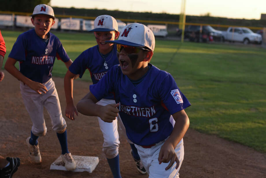 Midland Northern All-Stars celebrate a win against Lubbock Western All-Stars on Thursday, July 6, 2017 at Butler Sports Complex. James Durbin/Reporter-Telegram Photo: James Durbin