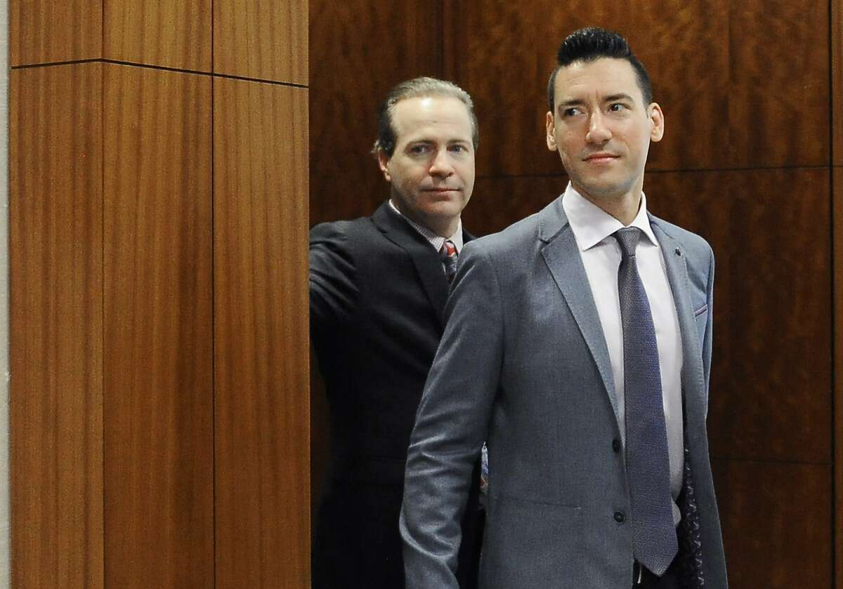 """FILE - In this April 29, 2016, file photo, David Robert Daleiden, right, with attorney Jared Woodfill leave a courtroom after a hearing in Houston. A federal judge deciding whether a fellow judge should disqualify himself from a lawsuit over an anti-abortion group's videos says he could not readily discern any appearance of bias. U.S. District Court Judge James Donato said Thursday, June 22, 2017, he was having trouble understanding how Judge William Orrick's affiliation with a non-profit and two Facebook """"likes"""" by Orrick's wife created an appearance of bias against defendant David Daleiden. (AP Photo/Pat Sullivan, File)"""