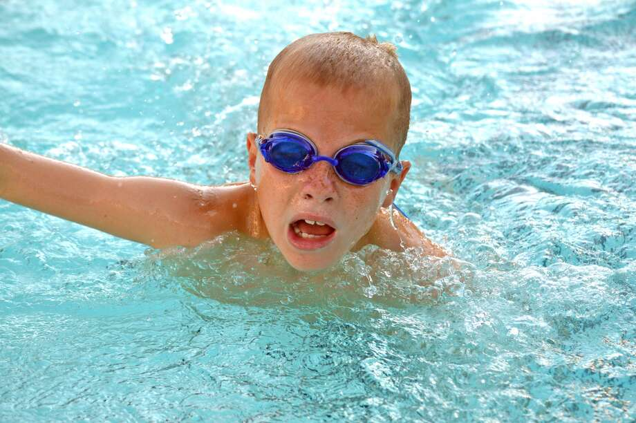 Aidan Schmidt of Water Works competes in the boys' 9-10 100-meter freestyle relay during Thursday's dual meet at Paddlers Swim Club in Granite City.