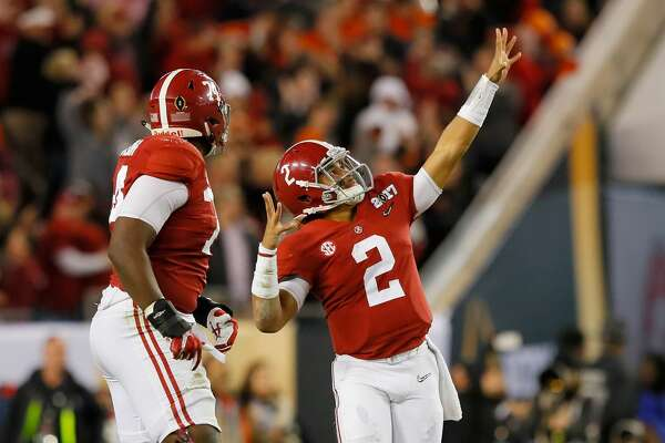 TAMPA, FL - JANUARY 09:  Quarterback Jalen Hurts #2 of the Alabama Crimson Tide celebrates after throwing a 68-yard touchdown pass during the third quarter against the Clemson Tigers in the 2017 College Football Playoff National Championship Game at Raymond James Stadium on January 9, 2017 in Tampa, Florida.  (Photo by Kevin C. Cox/Getty Images)