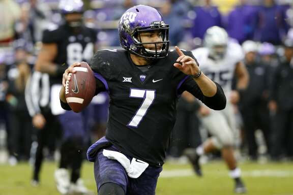TCU quarterback Kenny Hill (7) looks to pass during the second half of an NCAA college football game against Kansas State, Saturday, Dec. 3, 2016, in Fort Worth, Texas. Kansas State won 30-6. (AP Photo/Ron Jenkins)