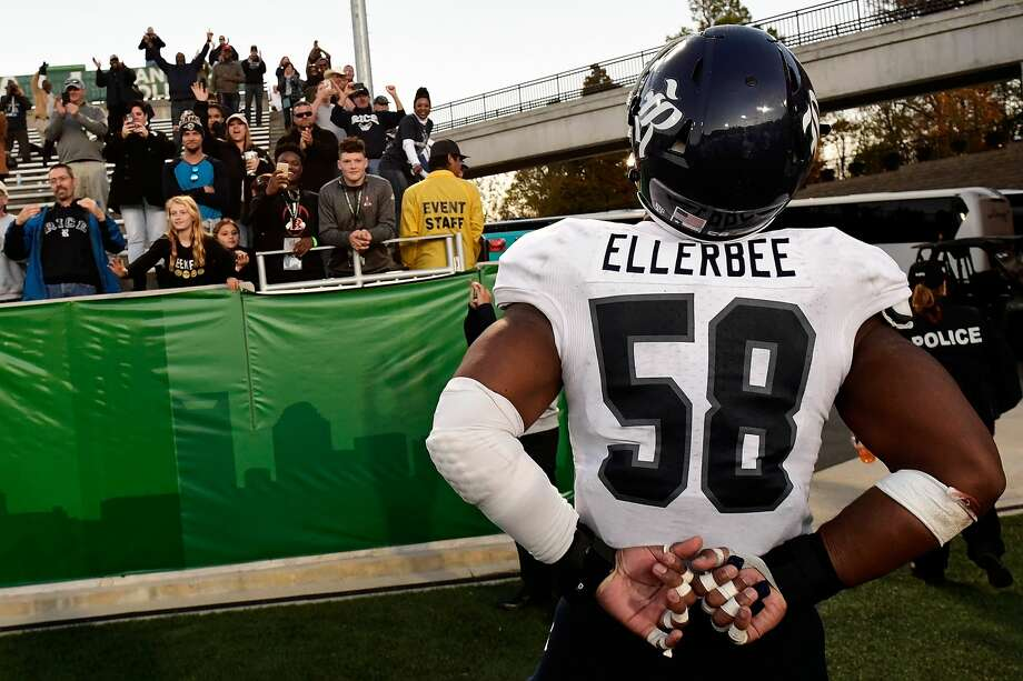 CHARLOTTE, NC - NOVEMBER 12:  Linebacker Emmanuel Ellerbee #58 of the Rice Owls stirs up the Rice crowd at the McColl-Richardson Field at Jerry Richardson Stadium following the Owls' victory over the Charlotte 49ers on November 12, 2016 in Charlotte, North Carolina.  (Photo by Mike Comer/Getty Images) Photo: Mike Comer/Getty Images