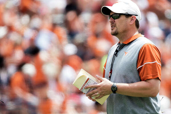 FILE - In this April 15, 2017, file photo, Texas head coach Tom Herman looks on during the Orange and White spring NCAA college football game in Austin, Texas. For the sake of the Big 12, new Oklahoma coach Lincoln Riley and Herman better live up to the hype. Following a season in which Big 12 football bottomed out, and with speculation about the long-term viability of the conference a constant talking point, its flagship programs are now both in transition. (Ricardo B. Brazziell/Austin American-Statesman via AP, File