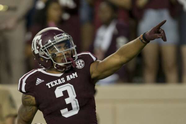 Texas A&M's Christian Kirk (3) celebrates after returning a punt 78 yards against New Mexico State during the first quarter of an NCAA college football game Saturday, Oct. 29, 2016, in College Station, Texas. (AP Photo/Sam Craft)