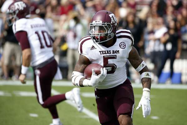 Texas A&M running back Trayveon Williams (5) looks for running room against Mississippi State in the first half of an NCAA college football game in Starkville, Miss., Saturday, Nov. 5, 2016. Mississippi State won 35-28. (AP Photo/Rogelio V. Solis)