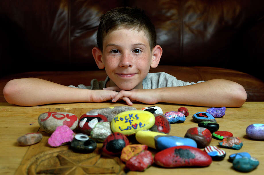 Bertis Whitehead, 11, has been painting rocks for his Rocks of Love project to pay for his grandmother's funeral. Whitehead has raised over $1,000. Photo taken Wednesday 7/5/17 Ryan Pelham/The Enterprise Photo: Ryan Pelham / ©2017 The Beaumont Enterprise/Ryan Pelham
