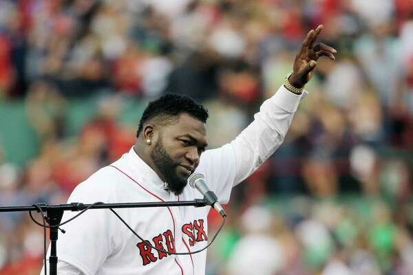 Retired Boston Red Sox baseball player David Ortiz waves to fan Friday, June 23, 2017, at Fenway Park in Boston as the team retired his No. 34 worn when he led the franchise to three World Series titles. It will be the 11th number retired by the Red Sox. (AP Photo/Elise Amendola) ORG XMIT: MAEA101