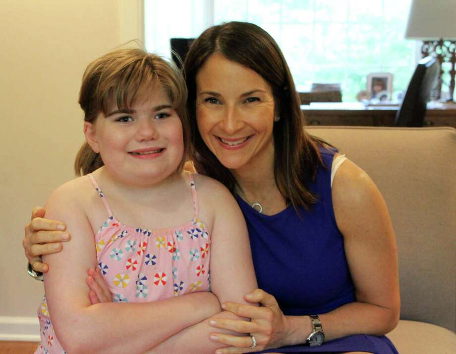 Jennifer Iannuzzi with her daughter, Sydney, who has the rare genetic disorder, Smith-Magenis syndrome. Photo: Stephanie Kim / Hearst Connecticut Media
