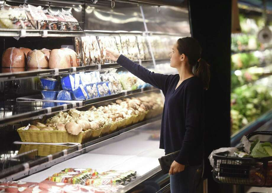 A customer shops in June 2015 at the then-newly opened Citarella Gourmet Market in Greenwich, Conn., which has differentiated itself from larger chains through exclusive selections on many items. Photo: Tyler Sizemore / Tyler Sizemore / Greenwich Time