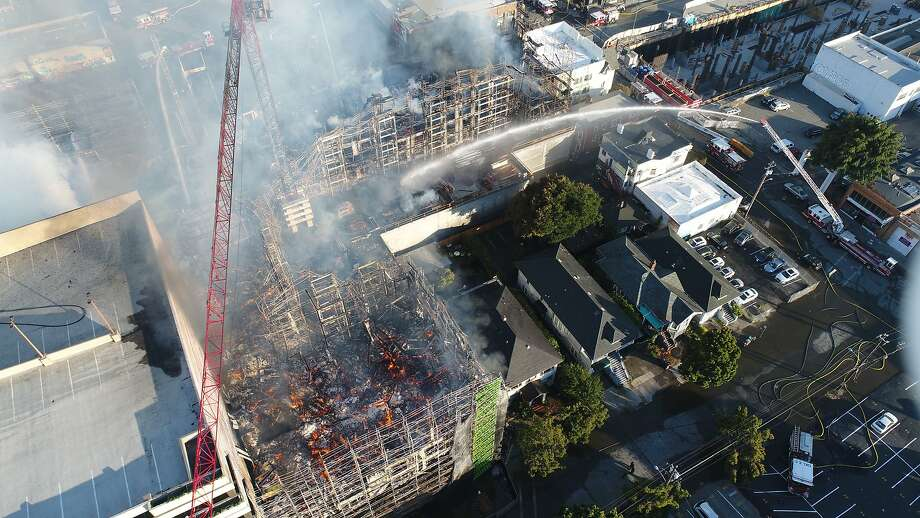 A huge blaze erupted before dawn Friday July 7, 2017 north of downtown Oakland, engulfing a six-story, mixed-use building that was under construction and prompting concern about a crane that was in danger of collapsing. Photo: Jim Stone, Special To The Chronicle