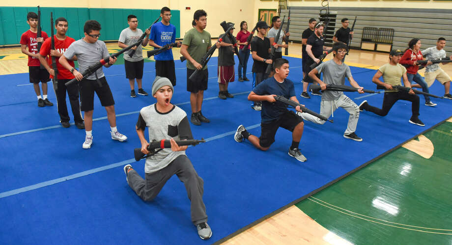Laredo ISD high school JROTC cadets go through drills and train on Thursday, July 6, 2017 as they prepare for upcoming JROTC competitions in the new school year. Photo: Danny Zaragoza