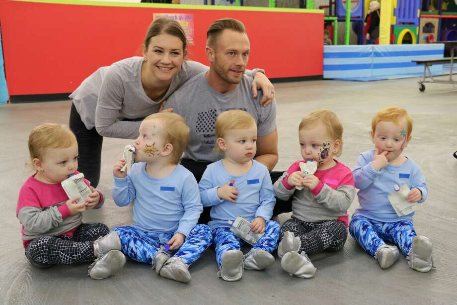 Danielle, Adam, Olivia, Parker, Riley, Ava, and Hazel Busby sit together. Photo: TLC