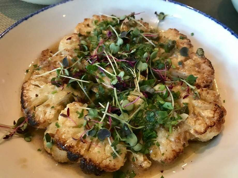 By all means, don't miss the Sautéed Cauliflower Steaks - a giant vertical slice of the whole cauliflower, cooked in butter with capers and dates at the new Starfish restaurant.